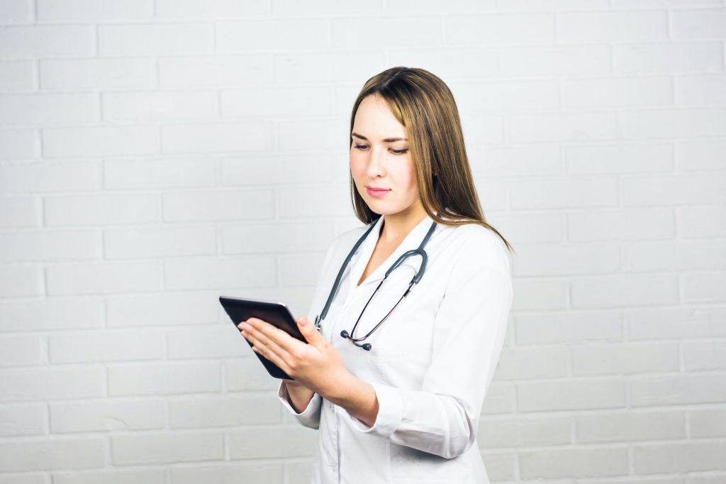Portrait of a nurse using a digital tablet. Copy-space